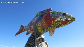 bright and cheerful fish watches over the majestic view towards gericke's point, sedgefield
